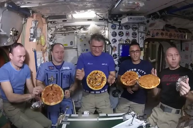 NASA astronauts have a ball in space with first ever floating Pizza Party