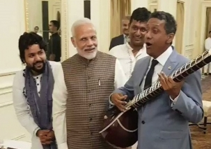 Seychelles President Danny Faure strums sitar at lunch hosted by PM Modi